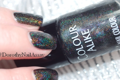 close up Colour Alike Black Saint swatch black holographic nail polish, artificial lightening