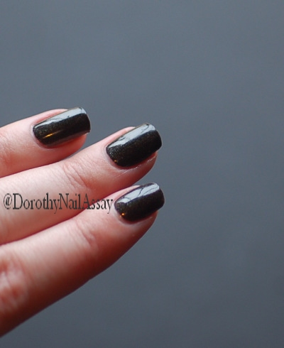Colour Alike Black Saint swatch black holographic nail polish, natural lightening, no sun.