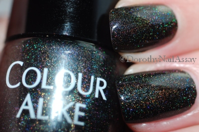 Colour Alike Black Saint swatch black holographic nail polish, artificial lightening