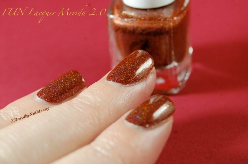 Merida 2,0 princess collection FUN lacquer, indoors artificial lightening.  A very deep chocolate polish!
