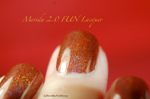 Merida 2,0 princess collection FUN lacquer, indoors artificial lightening.  A chocolate polish with beautiful holoness!