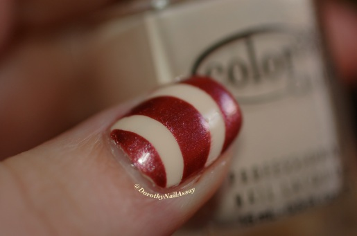 close up on Nail art Marsala tape with Color club poetic hues+ Chanel Sirocco, artificial light.