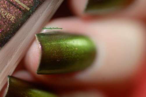 Poinsettia Fun lacquer swatch under artificial lightening.