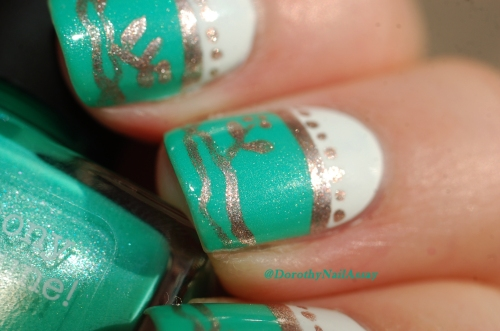 Close up on mu nail art freehand  inspired by english porcelain  with Picture pOlish Jade and Metallic Mush. Natural sunlight.