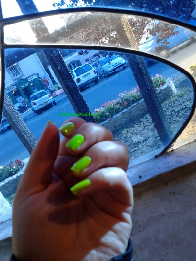 Swatch  floss gloss con limon, neon green wow, natural light, indoors church.