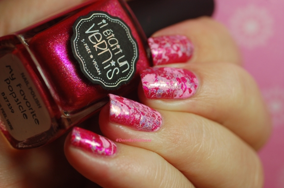 Pink holo splatter nails in artificial light