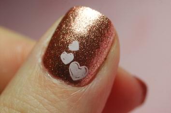 golden pink heart manicure